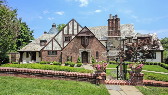 "This English Tudor home, designed by D. Wentworth, is one of the three original homes in ""The Gardens"" section of Westfield."