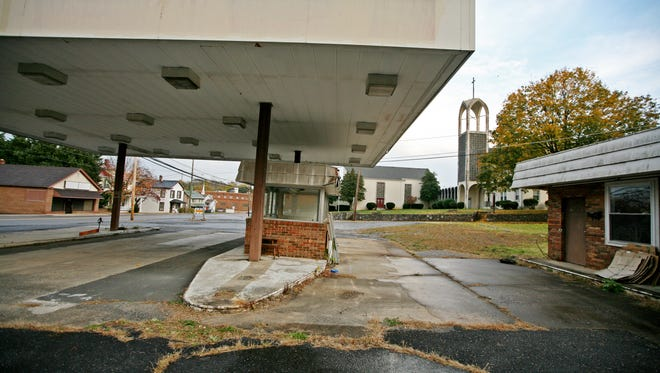 A former gas station has sat empty for years beside Marquis Memorial United Methodist Church. Businesses have come and gone in the buildings along West Beverley Street just west of downtown Staunton in this photo taken on Tuesday, Nov. 2, 2016.