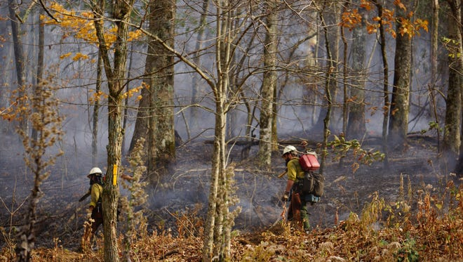 Firefighters bump down to secure a section of containment lines on the  Wine Spring Fire reported Wednesday November 1, 2016.