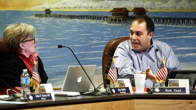 FILE - Naples City Councilman Sam Saad deliberates options for a medical marijuana ban with Vice-Mayor Dee Sulick during a meeting Oct. 1, 2014.