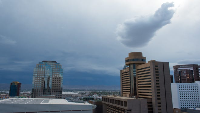 A storm rolls in over the rooftops of downtown Phoenix.