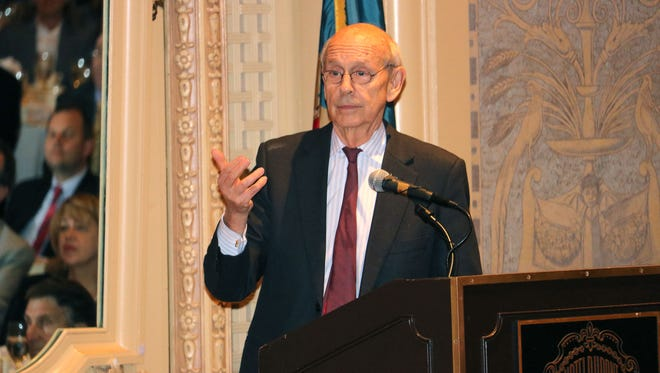 """U.S. Supreme Court Justice Stephen Breyer speaks at the Hotel du Pont Thursday, Nov. 3. Breyer signed copies of his new book, """"The Court and the World: American Law and the New Global Realities."""""""