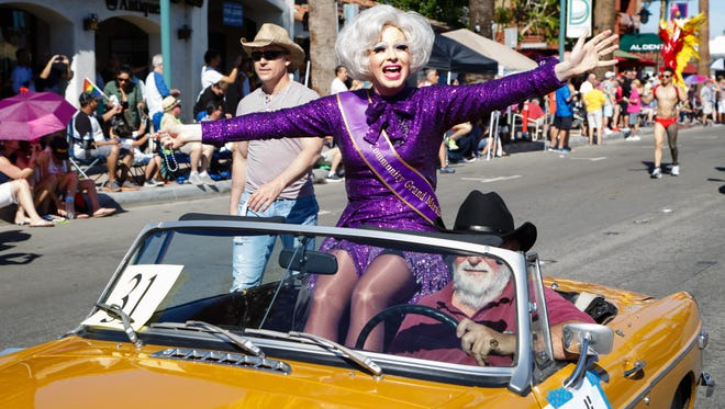 Grand Marshal Nicky Ciampoli rides in the Pride Parade through downtown Palm Springs, Sunday, November 6, 2016.
