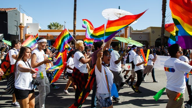 Students from local high school LGBTQ organizations march in the Palm Springs Pride Parade, Sunday, November 5, 2016.
