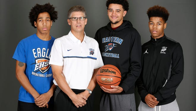 Eastern High School basketball coach David Henley, with players Javen Rushin, left, Caleb Williams and Braxton Johnson, on right. Nov. 7, 2016.