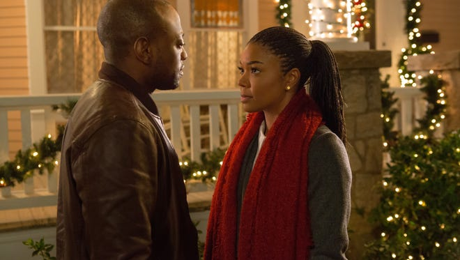 """Malachi (Omar Epps) reconnects with Rachel (Gabrielle Union) and the rest of the family in """"Almost Christmas."""""""