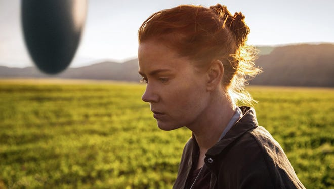 """Amy Adams as Dr. Louise Banks in """"Arrival,"""" directed by Denis Villeneuve. The movie opens Thursday at Regal West Manchester Stadium 13, Frank Theatres Queensgate Stadium 13 and R/C Hanover Movies."""