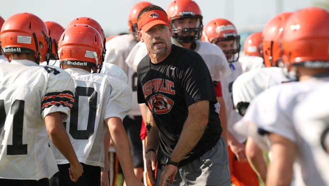 Wes Beachler, center, coached the Republic High School football team for four years.