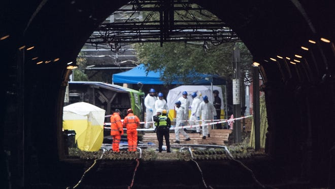 Emergency workers continue to work at the scene of a tram crash on Nov. 10, 2016 in Croydon, England.