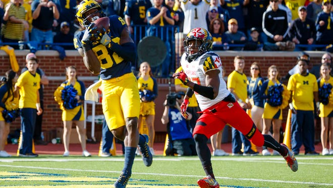 Michigan wide receiver Amara Darboh catches a touchdown pass against Maryland.