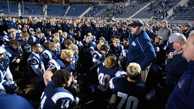 Evansville Reitz head coach Andy Hape talks to his team after their loss to East Central in the 4A regional at the Reitz Bowl Saturday, November 12, 2016.