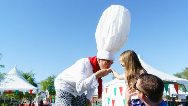 Tomm Belancich, know as Too Tall Tomm, entertains festival atendees at The 6th Annual Italian Festival at Rancho Mirage Community Park, Sunday, Noveber 13, 2016.