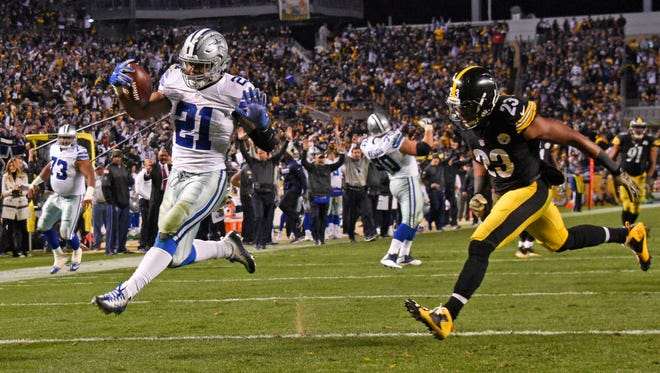 Dallas Cowboys running back Ezekiel Elliott (21) rushes for a touchdown as Pittsburgh Steelers free safety Mike Mitchell (23) chases during Sunday's game in Pittsburgh.