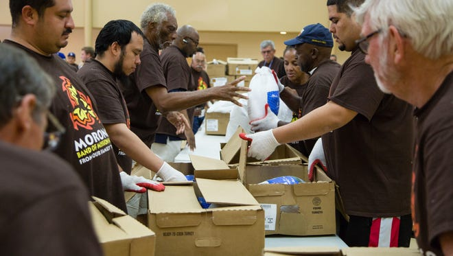 Volunteers and tribal members gather at the Morongo Community Center to help distribute frozen turkeys to local nonprofit and charitable organizations, Monday, November 14, 2016.