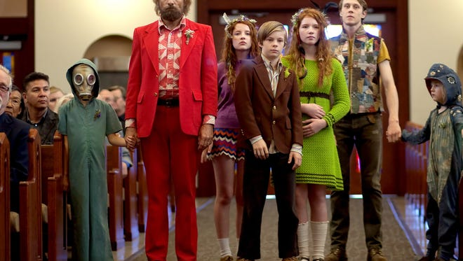 """In this image released by Bleecker Street, Shree Crooks, standing from left,  Viggo Mortensen, Samantha Isler, Nicholas Hamilton, Annalise Basso, George MacKay and Charlie Shotwell  appear in a scene from, """"Captain Fantastic."""" (Cathy Kanavy/Bleecker Street via AP)"""