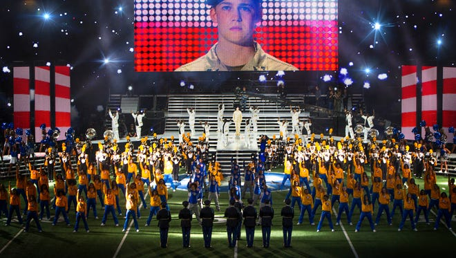 "Billy  (Joe Alwyn) on stage wth dancers and Alabama State Marching Hornets in ""Billy Lynn's Long Halftime Walk."""