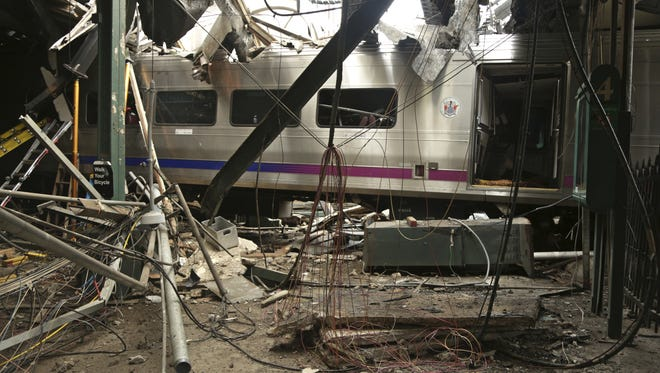 The Hoboken Terminal is damaged after a commuter train crash.