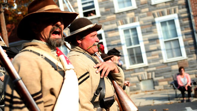 A member of the 7th Tennessee Infantry yells commands while marching in Saturday's Remembrance Day parade in Gettysburg.