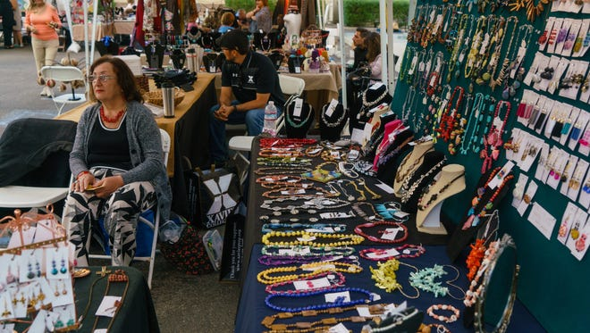 Vendors sell a variety of jewelry, food and art work at the annual Armenian festival held at St. Garabed Armenian Church of the Desert, Sunday, November 20, 2016.