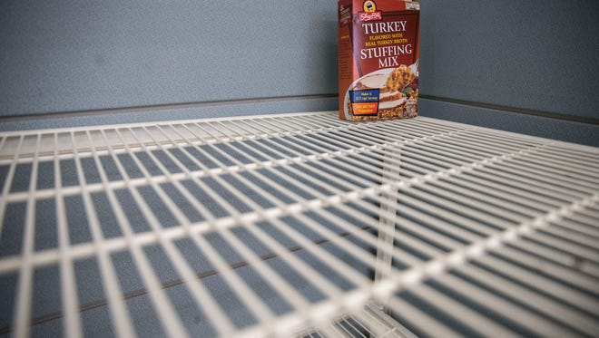 Some shelves in the pantry are low supplies. Ocean Community Services, a part of Catholic Charities, have less donations of toys and food this holiday season.Lakewood, NJWednesday, November 23, 2016.@dhoodhood