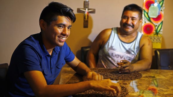 Juan Alvarado with his father Juan Carlos Alvarado Araujo on Nov. 2, 2016, in Phoenix.  Alvarado, a Foley scholarship recipient, attends Brophy College Preparatory school and is mentored by Eddie Martinez.