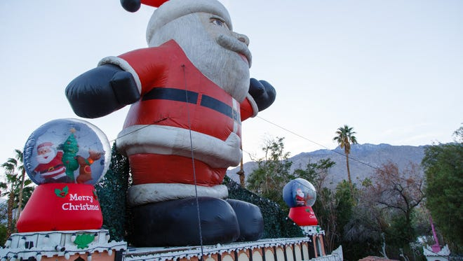 """Artist Kenny Irwin opened """"Robolights"""" Nov. 23, 2016, as planned, despite Palm Springs' decision to restrict visitor access to the annual light display.  The city said two code violations, including one for a large inflatable Santa that is secured to the artist's roof, are a threat to the safety of visitors."""