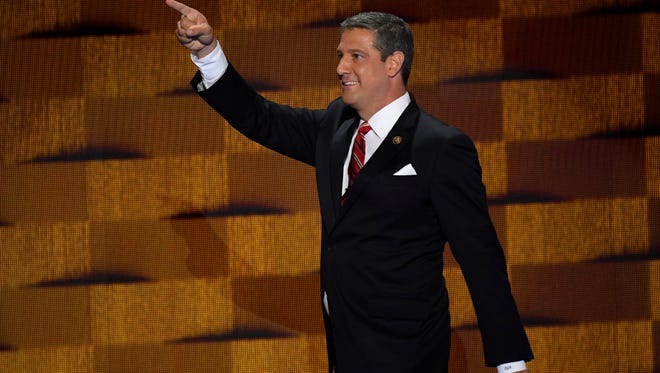 Rep. Tim Ryan, D-OH, walks on stage before speaking during the 2016 Democratic National Convention.