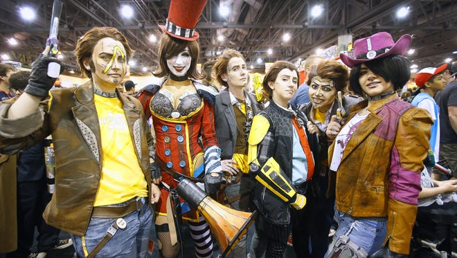 Cosplayers gather in the exhibitor hall during Phoenix Comicon Saturday, June 4, 2016 in Phoenix, Ariz.