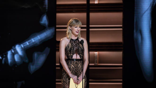 Taylor Swift presents Entertainer of the Year to Garth Brooks at the 50th Annual CMA Awards that took place at the Bridgestone Arena on Nov. 2, 2016 in downtown Nashville, Tenn.