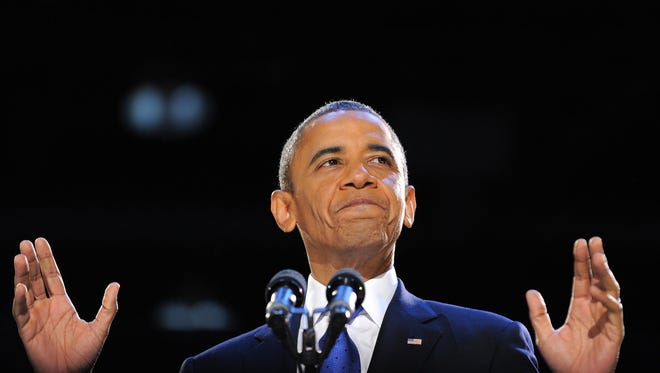 President Barack Obama addresses a crowd of supporters on stage on election night Nov. 6, 2012 in Chicago, Illinois.
