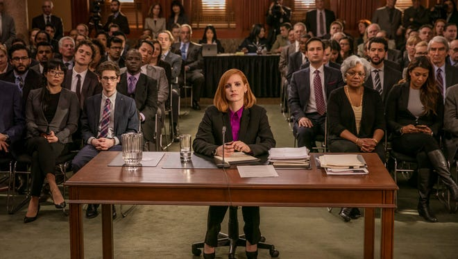 "Jessica Chastain, center, in a scene from ""Miss Sloane."""