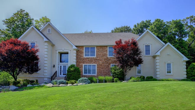 This five-bedroom home in Scotch Plains has five bedrooms, a state-of-the-art kitchen and a three-car garage.
