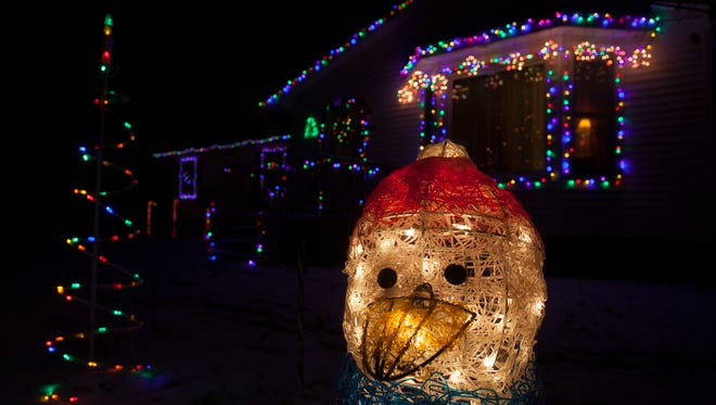 Taresa and Gower Lucas say spreading critter repellent helps protect wiring and outdoor decorations.