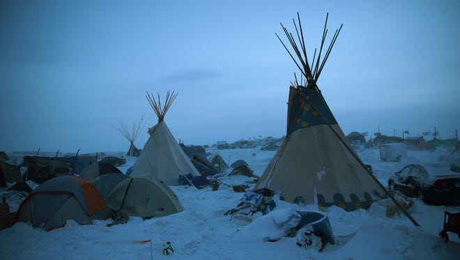 Activists at Oceti Sakowin near the Standing Rock Sioux Reservation brace for sub-zero temperatures expected overnight on Dec. 6, 2016, outside Cannon Ball, N.D.