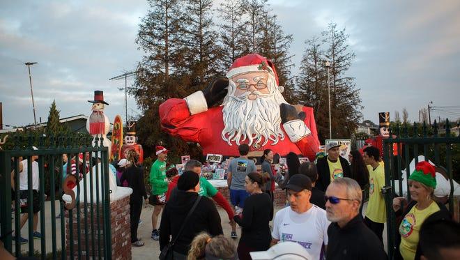 People bring gifts to be donated during the ninth annual Santa to the Sea half-marathon held at Nyeland Acres Sunday morning.