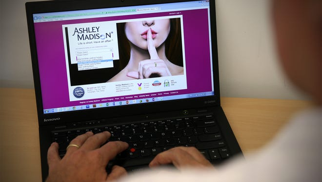 File photo illustration taken in 2015 shows a man browsing  the Ashley Madison website in London, England.