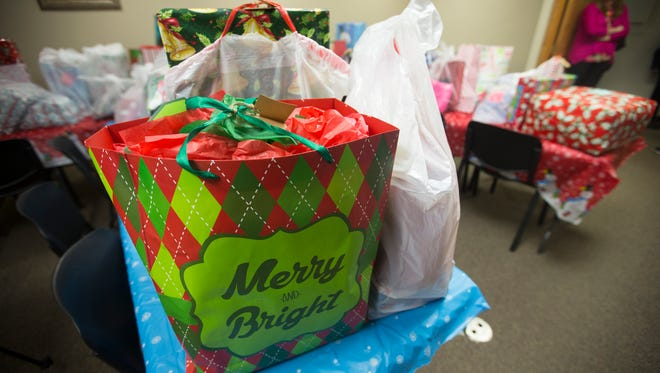The Vestal Elks Lodge dropped off over 700 presents for the 162 children served by Catholic Charities of Broome County on Monday, Dec. 19, 2016.