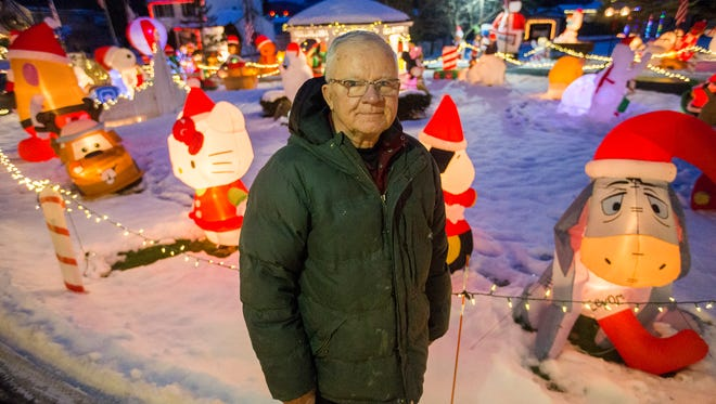 Town of Chenango resident Don Phillips, 72, with his ever-growing collection of Christmas decorations.