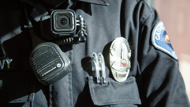 A Cathedral City police officer wears a body camera in December 2016.