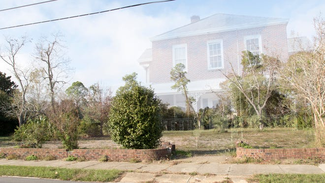 The lot where the John Sunday house used to be located now sits vacant at the corner of W. Romana and S. Reus streets in Pensacola on Tuesday, December 27, 2016.  Photo illustration by Gregg Pachkowski/Tony Giberson
