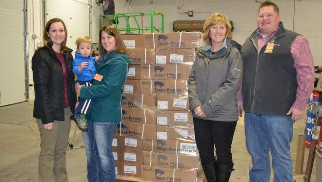 Wisconsin Pork Association donated 1600 pounds of pork loin to a southwestern Wisconsin food bank. Pictured (l-r) Mandy Masters (WPA Staff), Jessica Boehm and son Clement (WPA Board Member), Tammy Vaassen (WPA Staff), and Bryant Gill (WI Farm Report).