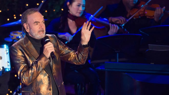 Neil Diamond performs at the 84th Annual Rockefeller Center Christmas Tree lighting ceremony on Wednesday, Nov. 30, 2016, in New York.