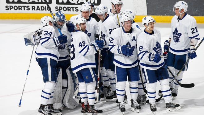 FILE - The Toronto Maple Leafs celebrate their win against the Florida Panthers at the BB&T Center on December 28, 2016 in Sunrise, Florida. The are hosting the Detroit Red Wings in the Centennial Classic.