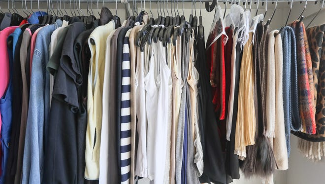 Clothing divided by function by professional organizer Tracy Varga, in her walk-in closet, at her home in Louisville, KY. Jan. 4, 2017