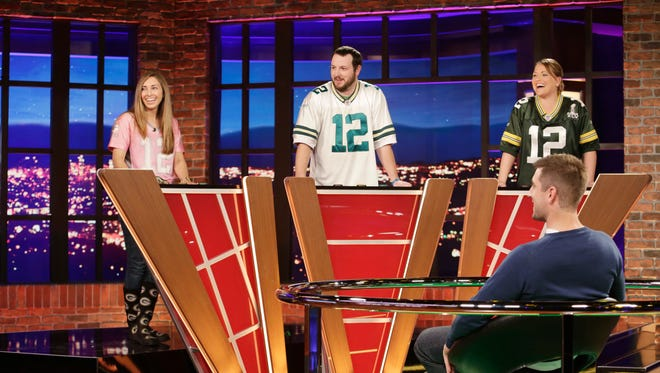 "Cassandra Hooyman of Marshfield, from left, Eric Bombinski of Freedom and Laura Raske of Madison step up to challenge Green Bay Packers quarterback Aaron Rodgers on Monday night's episode of ""Big Fan."""