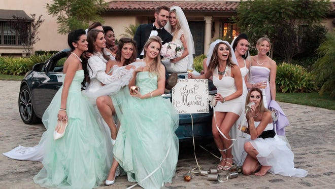 Nick Viall takes a group of women on a date posing for wedding photos.