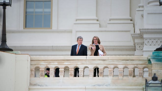 Senator Roy Blunt and an unidentified woman survey the progress of the construction of the inaugural platform at the U.S. Capitol. Construction continues on the platform for the inauguration of Donald Trump as the 45th President of the United States.
