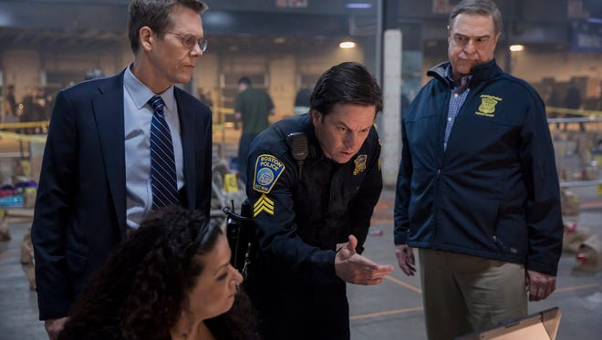 Kevin Bacon (from left), Mark Wahlberg and John Goodman star in 'Patriots Day.'