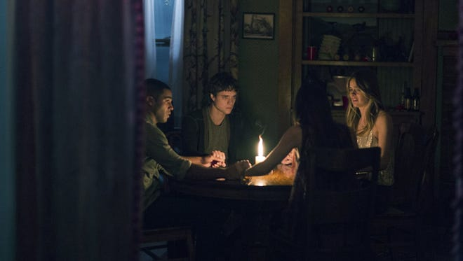 """Douglas Smith, Lucien Laviscount, Jenna Kanell and Cressida Bonas in """"The Bye Bye Man."""" The movie is playing at Regal West Manchester Stadium 13 and R/C Hanover Movies."""