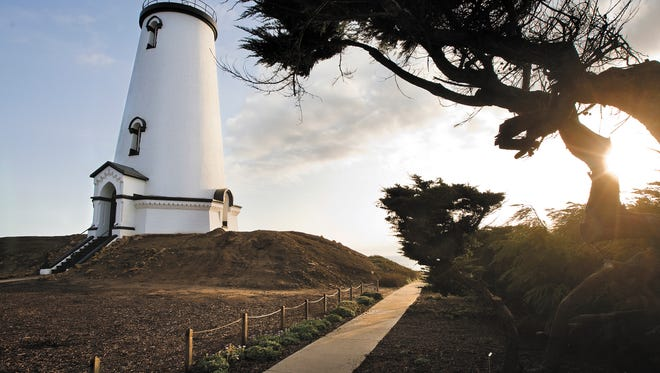 The sun sets behind the Piedras Blancas lighthouse just north of San Simeon in this 2012 file photo. President Barack Obama expanded the territory of the California Coastal National Monument, which includes Piedras Blancas and five other sites with more than 6,000 acres to the national monument.